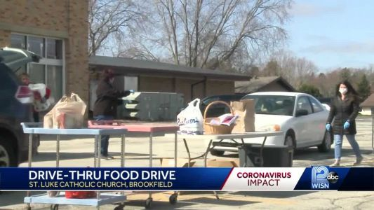 Parishioners hold drive-thru food collection for those in need