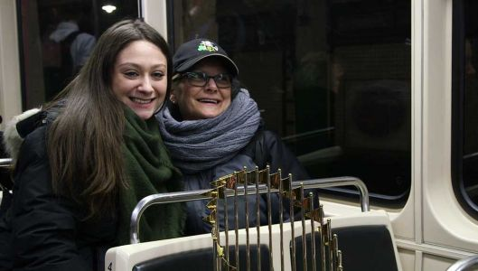 Best commute ever? Red Sox bring World Series trophy for a ride on the MBTA