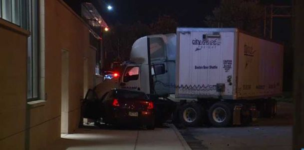 Crash involving semi hits building in Cincinnati's West End