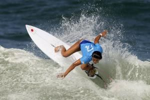 Nerves, joy, and modest waves at surfing's Olympic debut