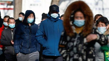China bans gatherings and travel in regional center after 63 locally transmitted Covid infections recorded near capital