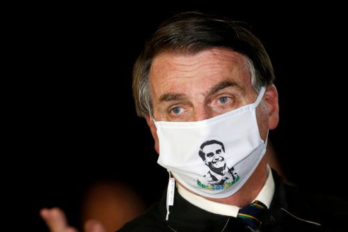 Brazil's Bolsonaro says lungs 'clean' after reported coronavirus symptoms
