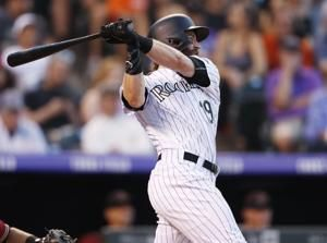 Rockies hit 5 home runs, rout Diamondbacks 19-2