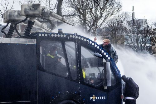 Dutch police use water cannon on anti-government protesters