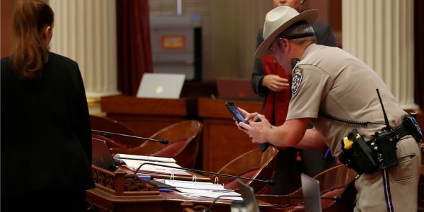 An anti-vaxx protester was arrested for dropping 'menstrual blood' on California lawmakers