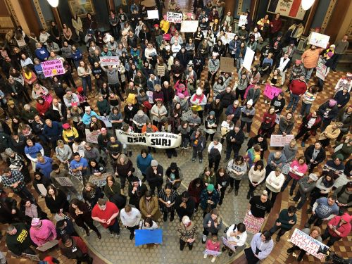 Cold forces women's march to move inside Iowa Statehouse