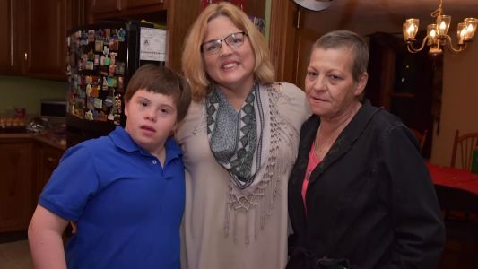 Teacher adopts student with Down syndrome after his mother dies of cancer