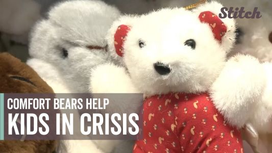 Police officers use 'comfort bears' to help children cope with trauma