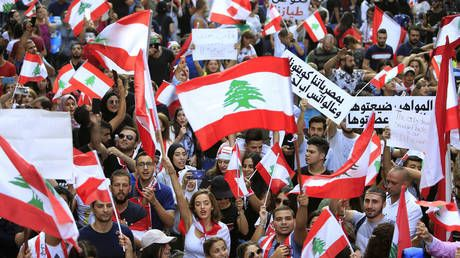 WATCH Lebanon protesters sing 'Baby Shark' to frightened child amid heated protests sparked by tax hikes