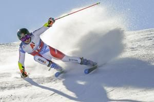 Swiss skier Caviezel has slim 1st-run lead in season opener