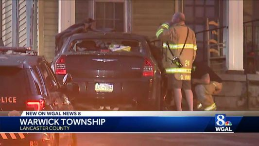 Woman suffers serious injuries after crashing into home