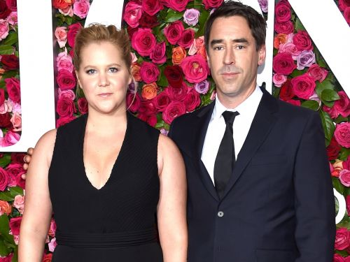 Amy Schumer's husband is on the autism spectrum, and she listed all the ways it made her 'fall madly in love with him'