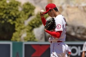 Angels' Ohtani wants to keep pitching despite arm troubles