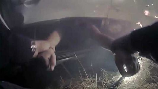 Dramatic video shows California police officer pulling woman from fiery crash