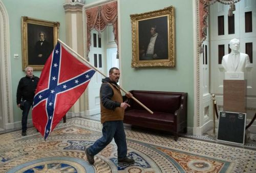 Man carrying Confederate flag inside US Capitol during riot arrested