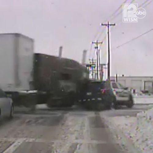 Dash camera records tractor-trailer, squad car crash