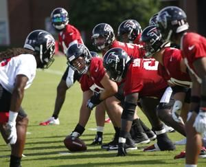 Falcons open camp with questions about hiring of Durkin