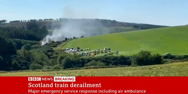 A train derailed in Scotland, sending plumes of smoke into the air and injuring an unknown number of people