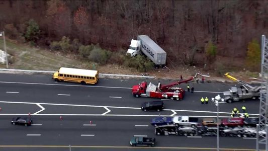Tractor-trailer, school bus involved in crash on I-95