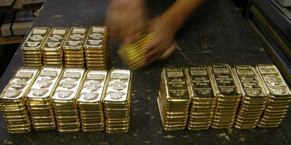 Gold swings higher in frothy trading after biggest plunge in 7 years