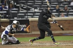 Hamilton, Braves outlast Mets 2-1 in 14 after deGrom shines