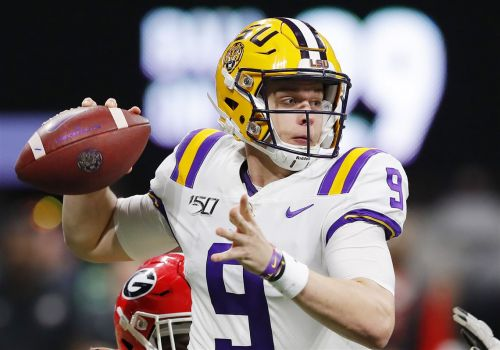 LSU quarterback Joe Burrow claims the Heisman Trophy
