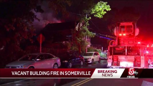 Crews battle fire at vacant Somerville building