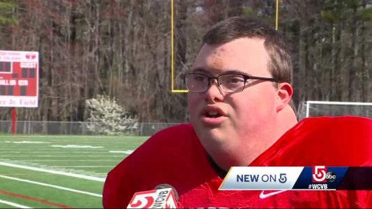 'Cam special': High school football teams help player with Down syndrome score touchdown