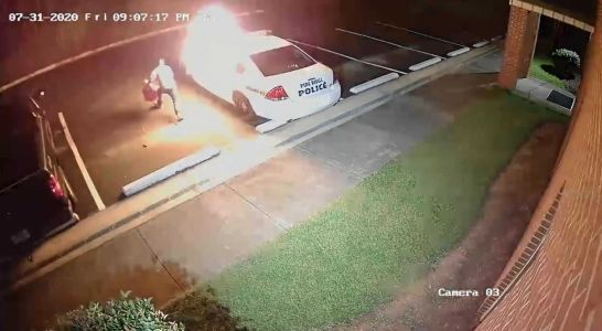 Caught on camera: Man dumps gasoline on police car parked at police station , then sets it on fire