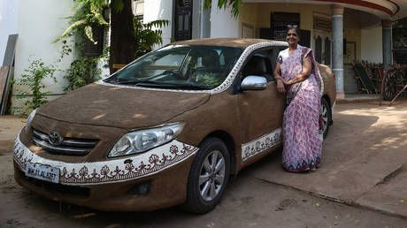 'Toyota Cow-rolla': Indian woman plasters her car with bovine DUNG to cool it down
