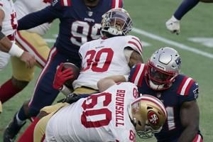 Wilson has 3 TDs before injury, 49ers crush Patriots 33-6