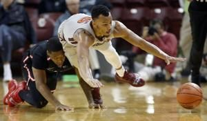 The Latest: No. 16 Virginia Tech tops Ball State 73-64