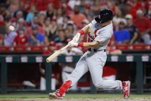 Edman's grand slam lifts Cardinals over Reds 7-4
