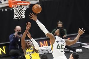 Minus injured Mitchell, Jazz rally to beat Pacers 119-111