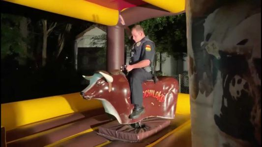 Texas police officer responds to noise complaint, winds up riding mechanical bull