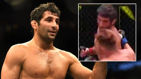 In a spin: UFC star ends fight with spectacular spinning backfist - then suggests poleaxed opponent should be given bonus