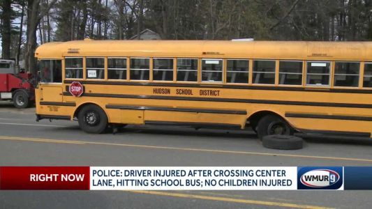 Driver injured after crossing center lane, hitting school bus in Hudson