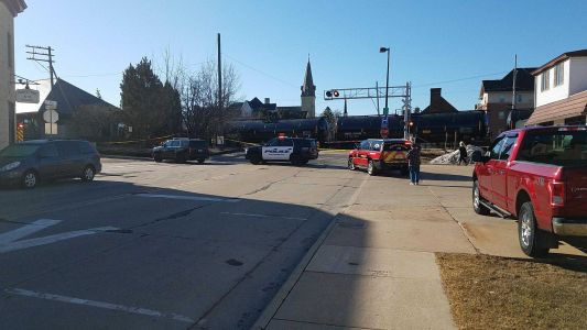 Train collides with semi, launching debris along Main Street in Oconomowoc