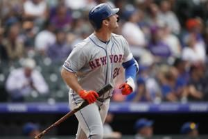 Mets put up four-run rally in 9th to beat Rockies, keep wild card hopes alive