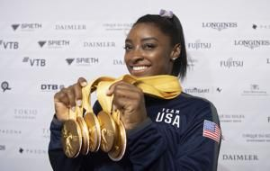 After record world medal haul, Biles a face of 2020 Olympics
