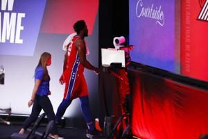 76ers C Embiid leaves game with left ankle injury