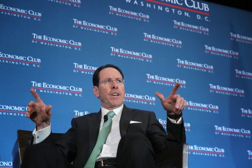 AT&T boss defends controversial succession plan