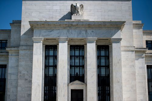 Fed raises rates, signals 2 more hikes coming in 2018