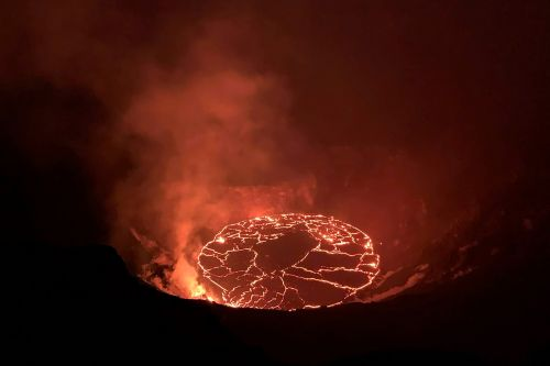 Lava spatters, flows inside crater of Hawaii volcano
