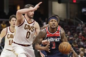 Beal scores 36 as weary Wizards down Cavs 124-112