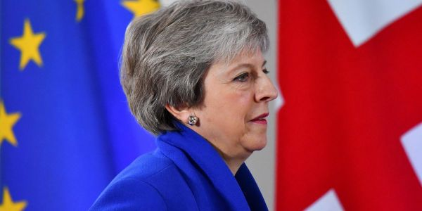 Theresa May delays Brexit deal vote to avoid huge defeat in Parliament