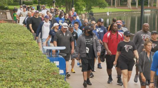 Local Coaches Unite for Coaches For Community Walk