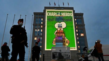 WATCH: Charlie Hebdo cartoons depicting Mohammed & other religions projected across France in tribute to slain teacher