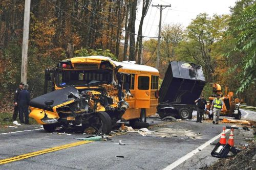Truck crashes with school bus in New York state, injuring drivers, little girl
