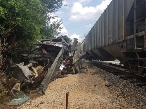Two people hurt in collision involving train, dump truck